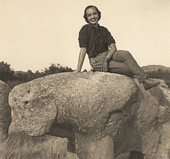 Vincente's daughter, Luisa, sitting atop an ancient bear shaped stone.