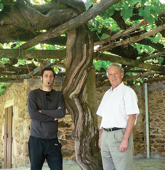 Winemaker Paul Garcia and owner Manuel Garcia next to a 450 year-old Albarino Vine. (Photo by Jason Tesauro for sommelierjournal.com)