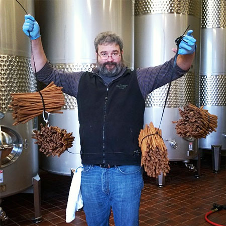 Bryan Ulbrich holding the cinnamon used to make Cinnamon Girl Cider.
